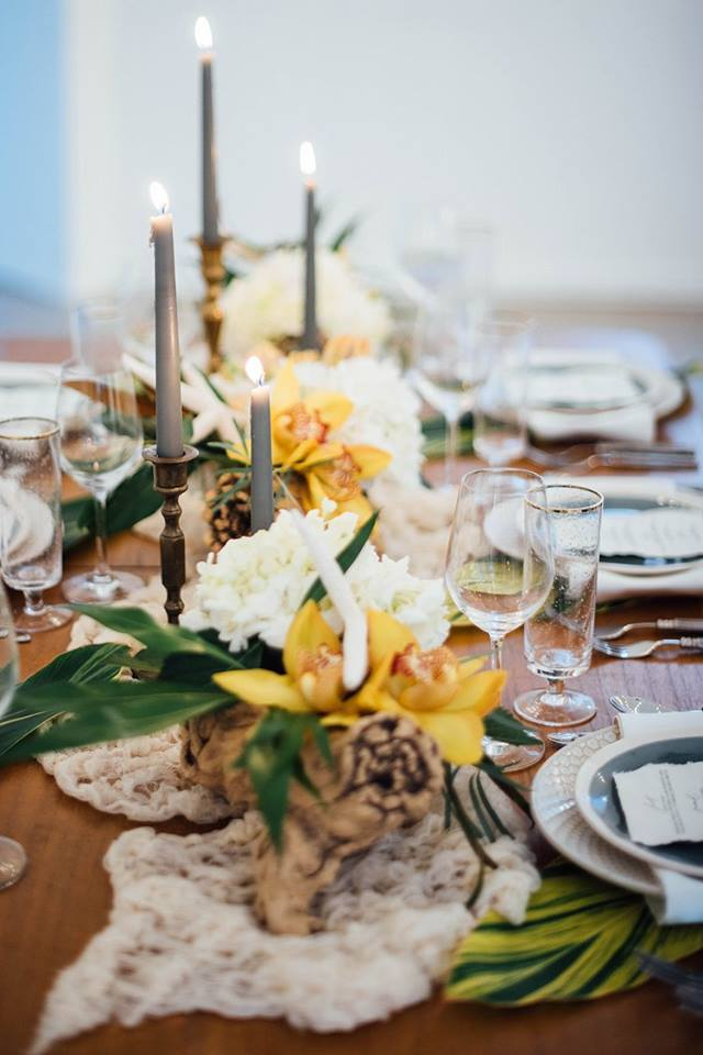 White and yellow table setting for tropical themed wedding