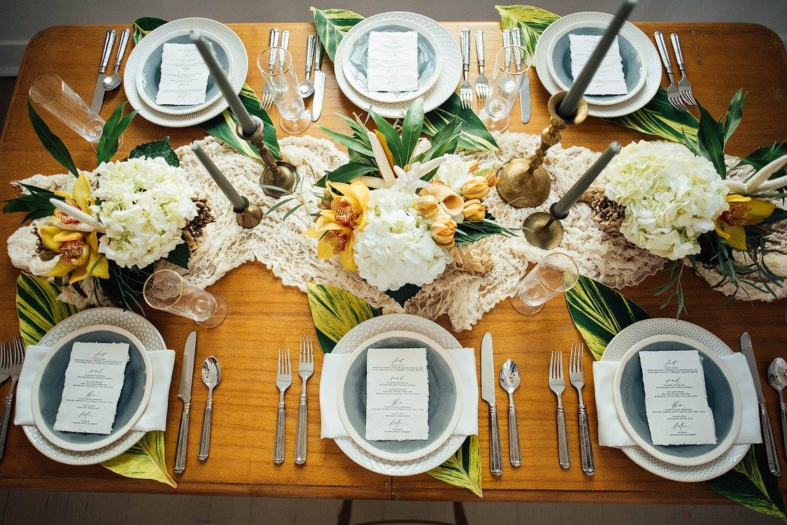 Table setting for tropical themed wedding