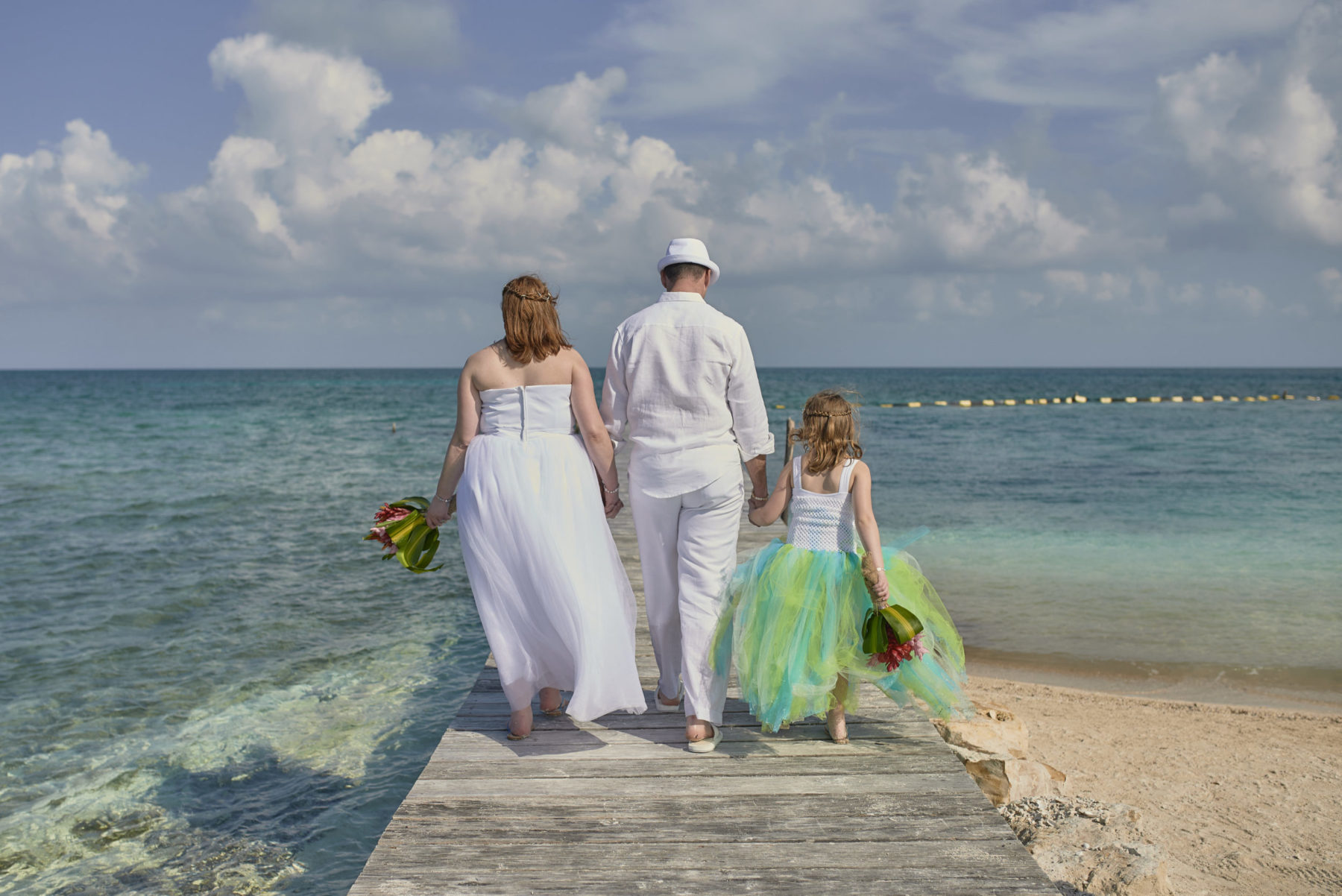 Family on dock at Starfish island wedding, Belize